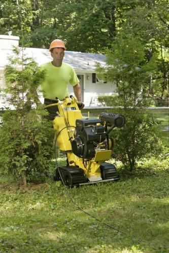 Man with L2 line Layer Machine in garden